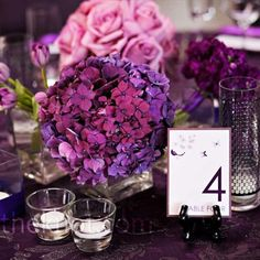 A squared off centerpiece of purple hydrangeas.