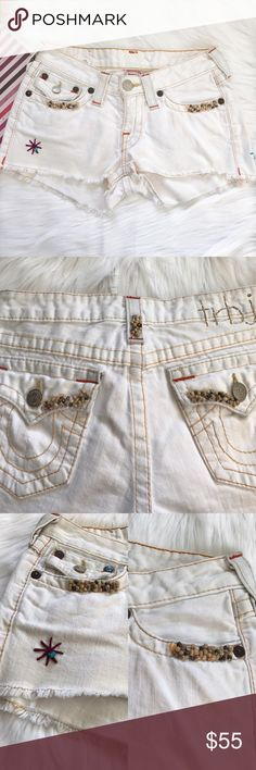"True Religion Cut Off Beaded Jean Shorts Pre-loved, Women's faded cut off jean shorts, with frayed hem, wooden beads detail, 7"" front rise, 12"" back rise, 5-pocket. Please feel free to ask questions. No trades. True Religion Shorts Jean Shorts"
