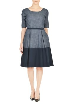 $80. Indigo chambray vitalizes our feminine fit-and-flare dress and spans over to the mod sixties with a cotton poplin color blocked hem and piped waist.