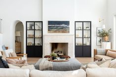 framed tv above fireplace Modern Lake House, Modern Mountain Home, Tv Above Fireplace, Home Fireplace, Fireplaces, Open Concept Floor Plans, Curved Sofa, Studio Mcgee, Family Room Design
