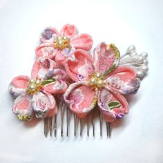 Pink Cherry Blossoms. Chirimen Tsumami Kanzashi. Made to order. $19.99, via Etsy.