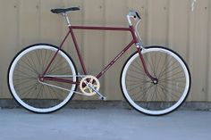 Fixie/Single Speed built from a 50's Schwinn Varsity. Painted Maroon Red. White deep v wheelset with flipflop hub made by Eighthinch. Update...