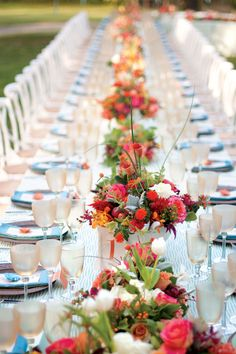 The reception table featured pale blue tablecloths, menus adorned with paper flowers, and individual centerpieces with roses, dahlia and hypericum berry punctuated by crabapples and kumquats