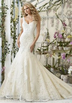 """Wedding Dress 2814 CRYSTAL BEADED EMBROIDERY CASCADES ONTO THE TULLE GOWN WITH ALENCON LACE APPLIQUES AND SCALLOPED HEMLINE  Available in Three Lengths: 55"""", 58"""", 61"""". Colors Available: White/Silver, Ivory/Silver, Light Gold/Silver."""