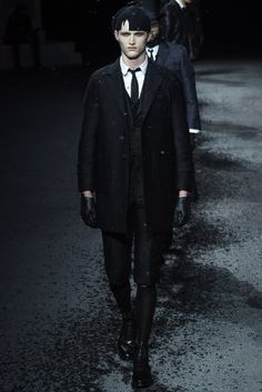 Thom Browne Menswear Autumn / Winter 2015 presented a dark noire suited collection during Paris Fashion Week.