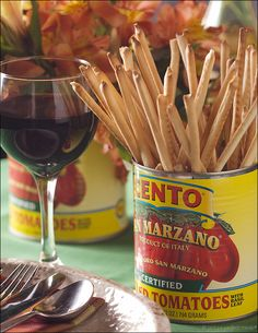 tomato cans, bread sticks and vino