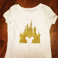 Tulip glitter transfer paper - iron on shirt. Stitched beading to the top of castle. Disney World shirt!