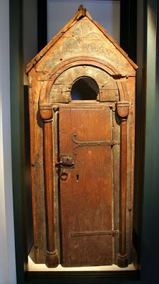 """A """"Giebelschrank"""", which is German for a cabinet with a pointed top. ca 1200. Notice that it was originally painted and is missing the edge trim on the top."""