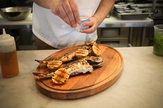 Whole-grilled fish dishes are a staple of the menu at Paralia #restaurant #Toronto. #Greek