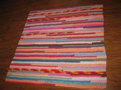 Girl random bits of yarn blanket