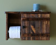 This toilet paper holder with storage cabinet and shelf, was made from reclaimed and repurposed natural pallet wood- stained with Minwax Provincial and sealed with Minwax Satin polyurethane. The toilet paper holder was made to be hung on a wall. The cabinet has two 2 metal hinges and one black knob. No hardware is included to hang this cabinet. Approximate measurements: 11 high x 18 wide x 6 3/4 deep. Approximate inside measurements: 9 1/2 high x 9 1/2 wide x 4 3/4 deep. H...
