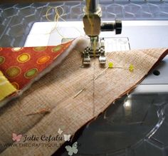 Getting perfectly pointy mitered corners on small quilted projects.