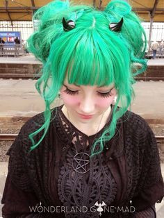 Green hair and horns, perfection.