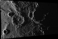 This image obtained by MESSENGER spacecraft features a ghost crater about 34 miles (55 km) in diameter near its center. Ghost craters occur when volcanic lava flows over and fills in craters, leaving only traces of the original feature behind. This crater likely experienced flooding by the lava that formed the Suisei Planitia on Mercury.