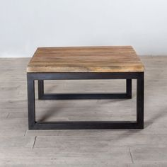 Reclaimed wood and weathered iron square coffee table from C.G. Sparks.