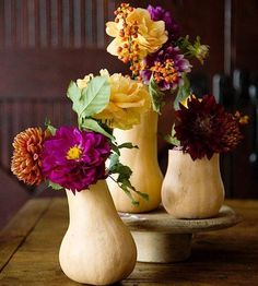 Centerpiece thoughts - what about some gourds and flowers? So pretty!