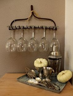 """Use an old rake to hang wine glasses...Click on the image for more information on """"5 DIY Kitchen Cabinet Organization Tricks"""" by Kitchen Bath Trends"""