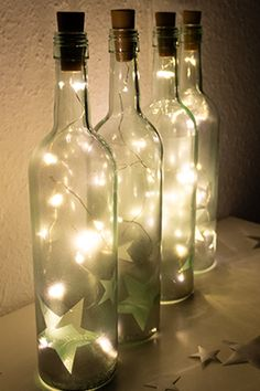Flaschenlichter selber basteln Fairy lights can not only be attached to the Christmas tree or window Christmas Crafts, Christmas Decorations, Christmas Tree, Diy Crafts To Do, Silvester Party, Christmas Poster, Bottle Lights, Wine Bottle Crafts, Decorative Accents