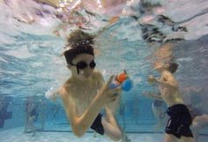 Diving for Easter treasure; Redmond kids chase eggs below the pool surface