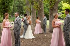 I like the interesting set-up of this photo, and how the bridesmaids and groomsmen are paired together as they were walking down the aisle together.