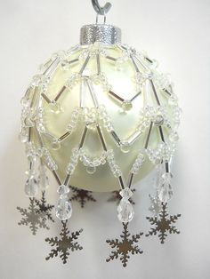 """Original design from the House of Whispering Firs """"Charmed Snow Flake"""". This beaded cover is a combination of glass seed, bugle, drop, faceted beads and metallic snow flake charms. """"Charmed Snowflake"""". 