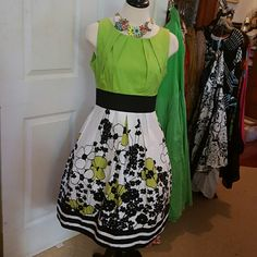 JUST CHOON COTTON DRESS NWTS, SUMMERY This beautiful Summer dress is cotton /spandex and has an elastic band in the waist. Exposed zipper up the back, lime green bodice and black and lime floral on white  cotton. Petticoat  and necklace not included. Just Choon Dresses