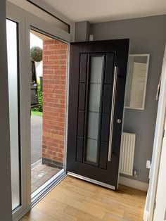 Another angle of the Rockdoor Vermont Continuity with Bar Handle in Anthracite Grey fitted in Derby Grey Composite Front Door, Grey Front Doors, Front Doors With Windows, Modern Front Door, House Front Door, House Entrance, Porch Entrance Ideas, Porch Extension, House Extension Design