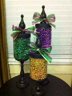 Mardi Gras beads + apothecary jars ugly bows though