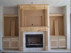 An electric fireplace insert with mantel and built ins!