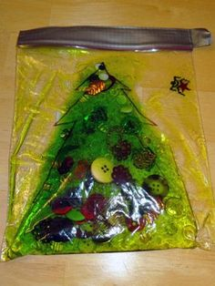 Do this but sandwich bag between two pieces of craft foam with tree shape cut out of middle.  Christmas tree sensory bags - enjoy some Christmas sensory play with just a few simple materials || Gift of Curiosity