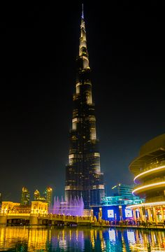 Tips on must-see buildings and sights in Dubai and Abu Dhabi, UAE for your travel happiness. Pictured: The Burj Khalifa (the tallest building in the world) looks beautiful lit up at night!