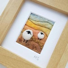 Original textile art by British artist Maxine Smith. A needle felted and embroidered miniature sheep landscape picture inspired by the natural environment. Textile artist Maxine Smith takes inspiration from the dramatic landscapes, hillsides and hedgerows of Shropshire, England. The #LandscapeNature