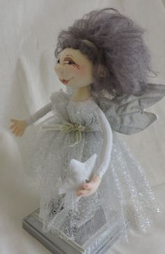 Silver Angel. Jill Maas Maggie pattern reduced to 9 inches to top of hair...about 8 inches to top of head.