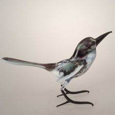 Blown Glass MagpieFigurine is a hand-created glass figurine made in technique of lam. http://russian-crafts.com/glass-figurines/glass-birds/glass-magpie-figurine-en.html