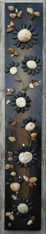 FREE SHIPPING This piece will be made to order . Created from all natural materials. The flowers petals are pebbles in their natural state. The reclaimed wood is painted in acrylics, and sprayed lightly with sealant to give it a shiny appearance. The back/reverse side is also painted. A hook will be placed vertically on the back. Approx measurements of the piece pictured are 30 inches long, and 3 inches wide. I always love special requests! If you have any questions, please contact me....