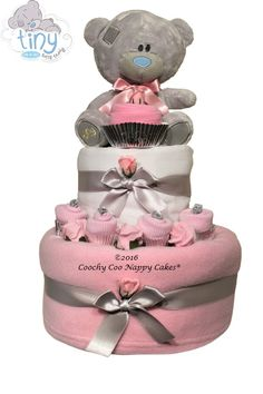 Baby girl silver teddy bear nappy cake is a perfect gift for a baby girl. A traditional teddy bear with a contemporary twist, a perfect gift for parents.
