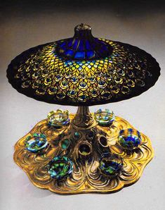 유 Illuminating Lamps 유 Peacock centerpiece table lamp, c. 1898