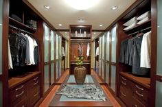 contemporary closet by Danenberg Design - Cherry wood and frosted glass sliding doors