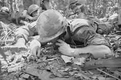 A U. S. 173rd Airborne Brigade radioman calls for artillery support as he and his buddies are pinned down by heavy Viet Cong fire here March 14th, 1966