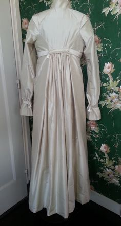 For Sale: This brand new made and one of kind cream silk ( dupion of a high quality) pelisse with soft and light cotton lining .  The pelisse will be fit on size 38, 40, 42 (Eur) 10/12/14 (UK) 8/10/12 (USA)  For a size 42, 14UK or 12 USA it is importend to know that the pelisse will fit only if your shoulders are not to big . Measurement from shoulder to shoulder seam is 38 cm. Front length from Highest shoulder point till bottom ( HSP) is 145 cm.
