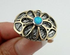 Checkout this amazing product Silver ring with Opal Center at Shopintoit