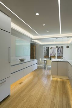 Aurora Square, Reveal Wall Wash, and LED Softstrip make this modern kitchen design complete. The lighting perfectly offsets the Modern Italian cabinetry Kitchen Ceiling Design, Plaster Ceiling Design, Kitchen Ceiling Lights, Ceiling Light Design, False Ceiling Design, Led Ceiling Lights, Room Lights, Home Decor Kitchen, Lighting Design