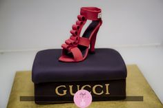 Sugar shoe on a Gucci box made of cake!  www.stylecakes.ca