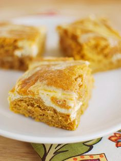 PUMPKIN ROLL BARS  -  6 T. unsalted butter, melted...1-1/2 c granulated sugar...2 large eggs...1 (15 oz.) can pumpkin...1/4 c. water...2 c. all-purpose flour...2 t. ground cinnamon...1/2 t. ground cloves...1/2 t. ground ginger...1/2 t. ground nutmeg...1 t. vanilla...1 t. baking soda...1/2 t. baking powder...1/4 t. salt  -  FILLING  -  8 oz. cream cheese, softened...1/4 c. granulated sugar...1/2 t. vanilla...1 large egg