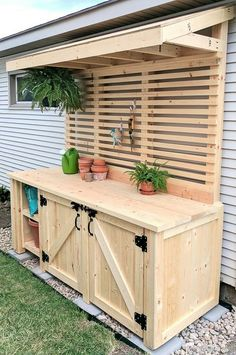 (Or backyard bar?)Shed DIY - DIY Potting Bench with Hidden Garbage Can Enclosure! Reality Daydream Now You Can Build ANY Shed In A Weekend Even If You've Zero Woodworking Experience! Station D'empotage, Potting Station, Grill Station, Cozy Backyard, Backyard Landscaping, Diy Landscaping Ideas, Luxury Landscaping, Sloped Backyard, Backyard Seating
