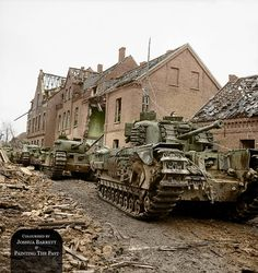 Churchill tanks of the 6th Guards Tank Brigade supported by infantry of the 2nd Gordon Highlanders (seen in windows of the large ruin) drive along a badly damaged street in Kleve, Germany. 12th of February 1945. Montgomery's 21st Army Group after Operation Market-Garden advanced towards the Rhine. By mid-January 1945 it had reached the Rur. In February the Canadian First Army launched Operation Veritable. Elements of the British XXX Corps entered Kleve on February 11.