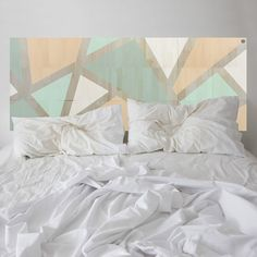 Minty goes to Mayfair. This KALEIDA headboard has been thoughtfully designed, balancing a kaleidoscope of fashionable colours. Strips of natural eco-wood are revealed between the hand-painted coloured sections.