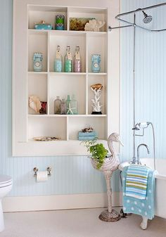 Building shelves into your bathroom wall you can create more space for decor in your small bathroom.