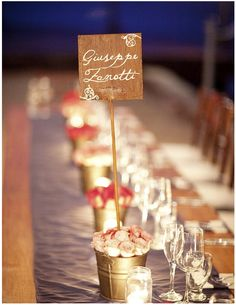 table name idea In a bucket with sea sand and more rustic wooden sign Filled with lindts?