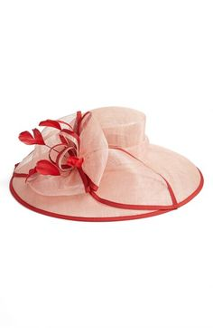 Floaty feathers and a gorgeous flower accent the crown of a breezy sinamay hat…
